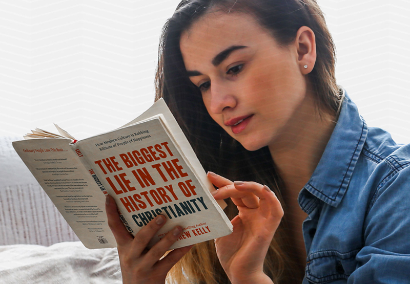 Woman reading The Biggest Lie in the history of Christianity